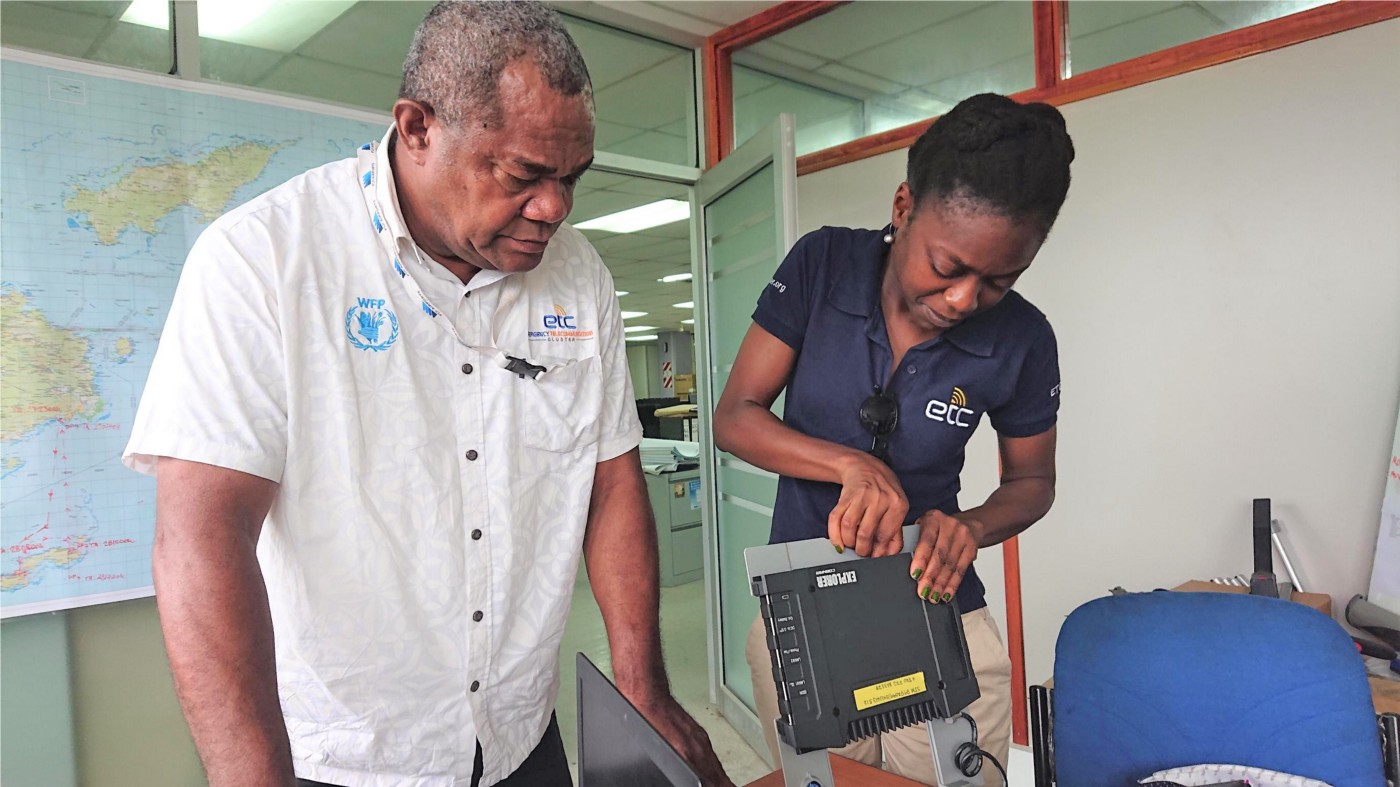 The ETC Coordinator and the Telecommunications Project Officer from Fiji's National Disaster Management Office prepare Inmarsat equipment for deployment. Photo: Fiji NDMO